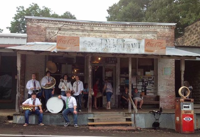 Memphis Second Line Jazz Band marches to the opening of Southern Junkers Vintage Market in Overton Square