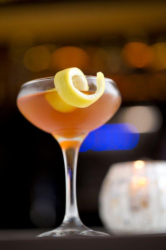 Henry McKenna bourbon cocktail with curaçao and lemon juice