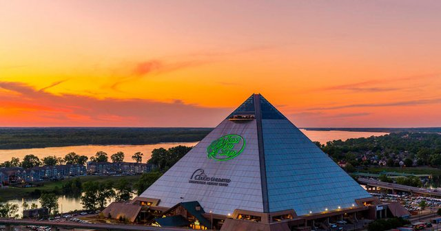 Pyramid exterior with sunset, sign lit.jpg