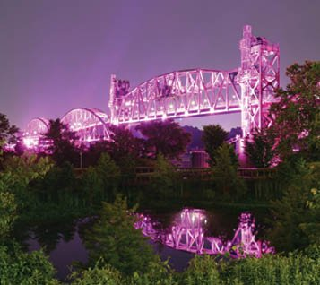 Clinton_Presidential_Center_Park_Bridge_lit_Courtesy_of_the_Clinton_Foundation_-_Photo_by_Nelson_Chenault.jpg
