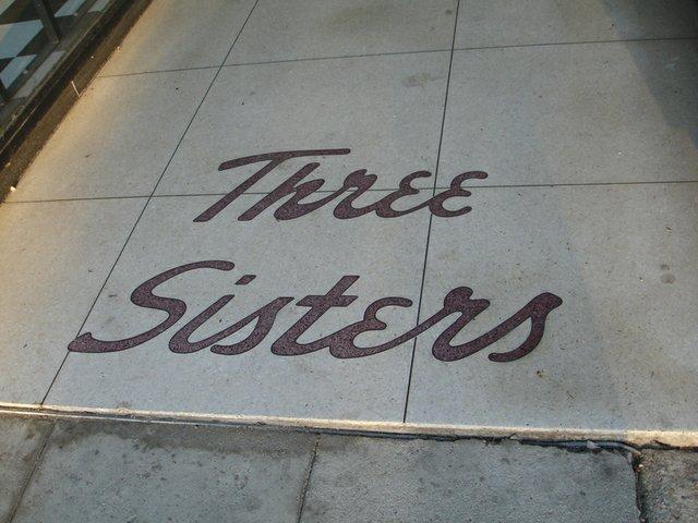 ThreeSistersSidewalkSign.jpg