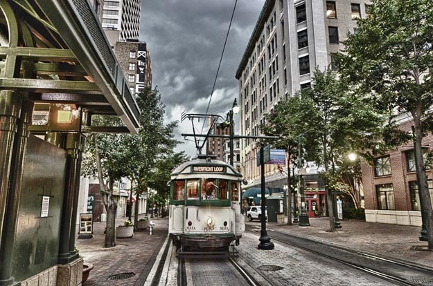 A Riverfront Loop trolley rumbles down the Main Street Mall.