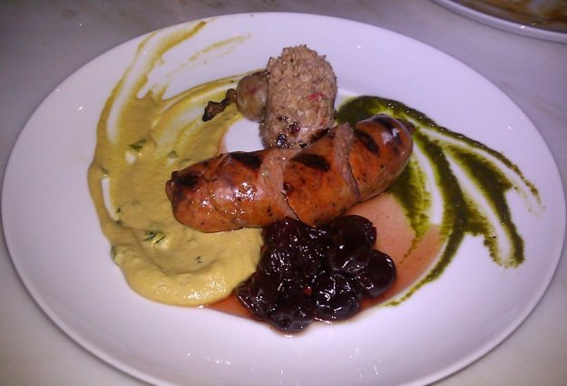 Merguez and duck sausage with sweet and sour cherries: one of Acre's new small plates.
