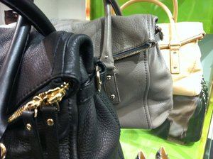 Satchels by Kate Spade at the new Kate Spade boutique in Saddle Creek.