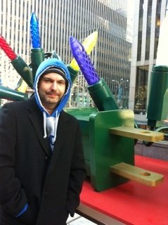 Greg in front of enormous Christmas lights at Rockefeller Center in NYC