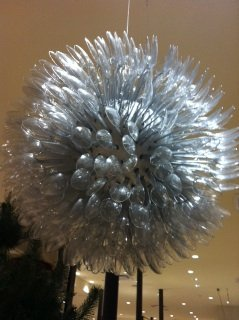 Giant snowflake made from recycled clear plastic spoons at Anthropologie in Memphis.