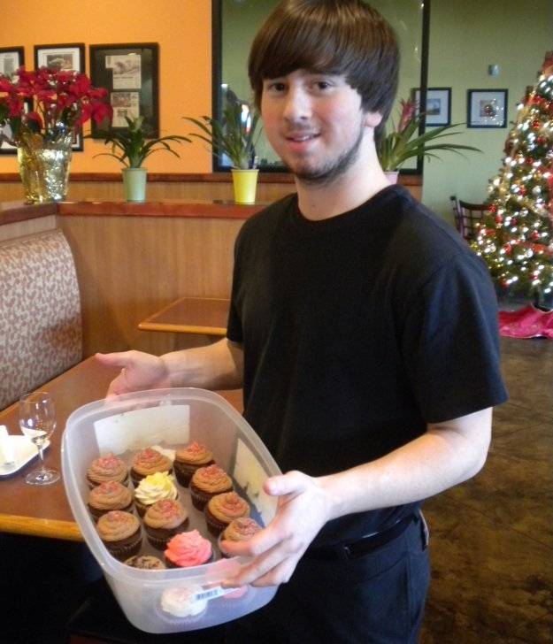 Michael Maxey with Charlene Pao's delicious homemade cupcakes.