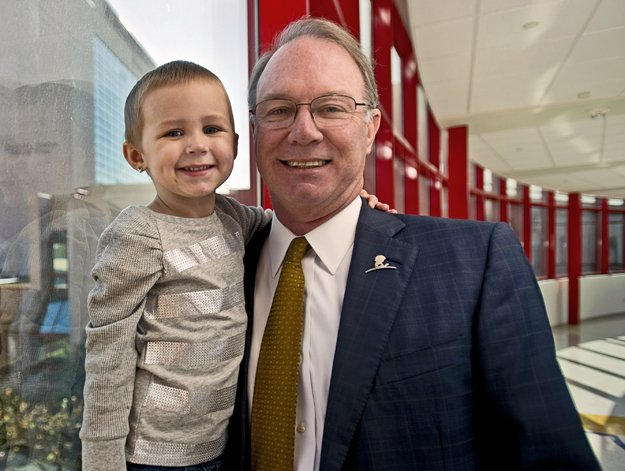St. Jude director and CEO Dr. William Evans with 3-year-old patient Kylie Overton.