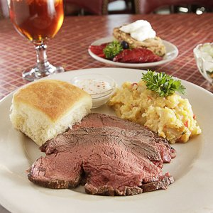 At the Woman's Exchange, Rev's famous beef tenderloin is served with horseradish sauce and two sides.