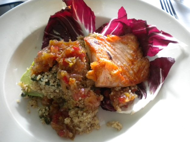 The avocado salad at Rizzos Diner is stuffed with quinoa and chow-chow and topped with salmon.