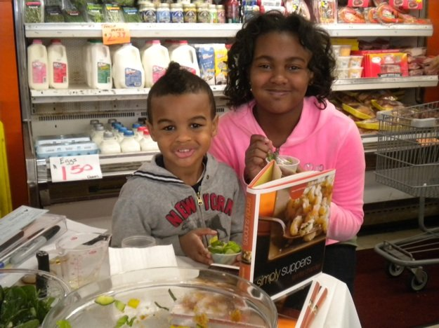 "Jackson and Jurni Williams sample ""Strawberry Fields"" salad Saturday at Easy Way."