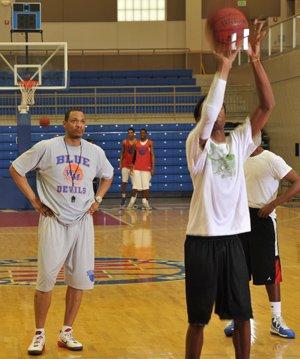 Marcus Brown (left) coaching the West Memphis High School Blue Devils basketball team.