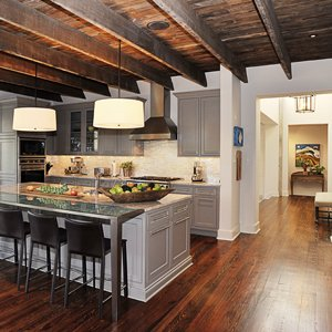 A transitional-style kitchen blends the traditional and contemporary, with boards that originally saw use in an old Lowenstein's Department Store warehouse.