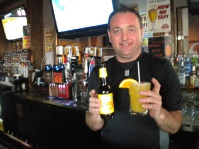 Mike Turner, manager of Jack Magoo's on Broad Ave., with Wheach Peach Wheat, his new favorite beer for summer.