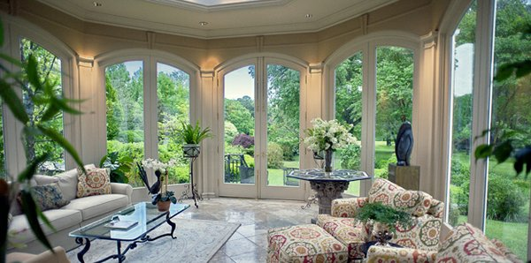The solarium designed by John Millard of Millard and Stevens offers a panoramic view of hte glorious grounds.