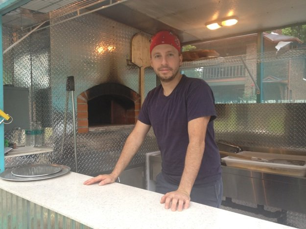 Jeremy Denno's customized pizza truck includes a wood-fire oven.