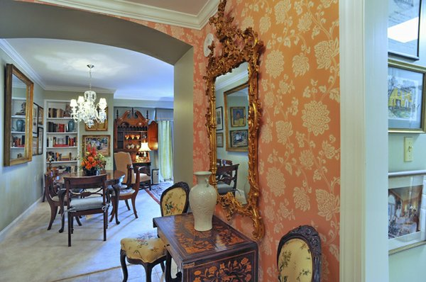 An elegant entry foyer leads to an open living/dining room.