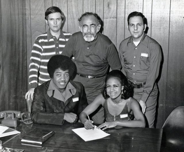_images_uploads_gallery_Jo-Jo-Benson-and-Peggy-Scott-standing-Tommy-Couch-Jerry-Wexler-and-Mitchell-Malouf-.jpg