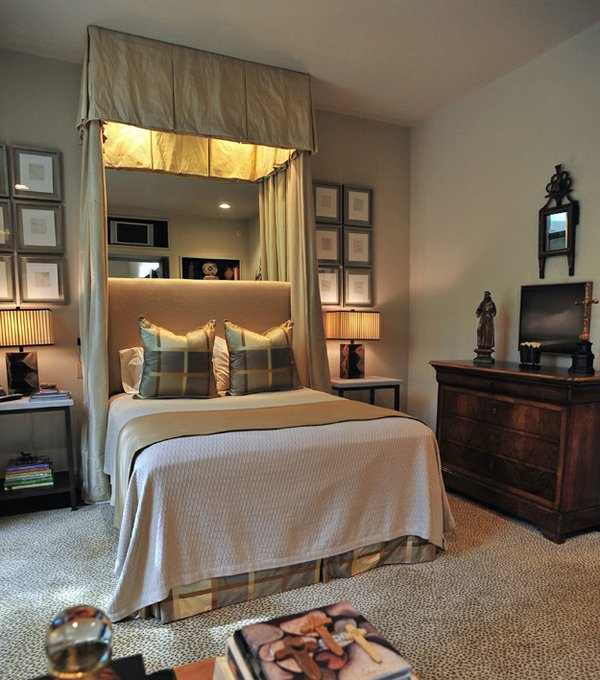 A set of 12 lithographs frames the bed in the newly updated master bedroom.
