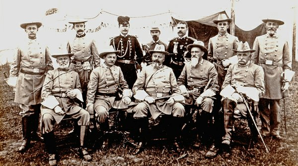 Colonel Robert Bogardus Snowden – the first one – poses with other Confederate Army officers; the date and location are unkown. He's the one in the middle, with the sword across his lap. - photograph courtesy Snowden Family