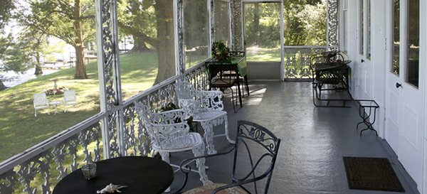 The original house erected in 1919 featured a simple wooden screened-in-porch stretched across the lake side of the home, but the 1949 expansion transformed it into this oasis, a wonderful place to sit in the morning and evening – all day long – and ...