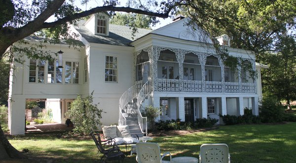The rear of the house, facing the lake, is a shady retreat. The Snowdens were world travelers, and on a trip through Louisiana, Grace noticed a Greek Revival-style home in the Bayou Country. When the Snowden House was expanded in 1949, she asked the ...
