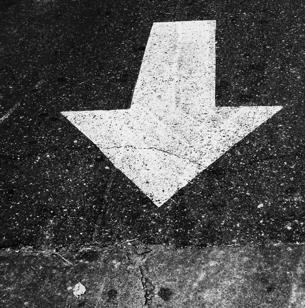 Pavement Markings III, Arrow Out (2010) From a photographic series of pavement markings.