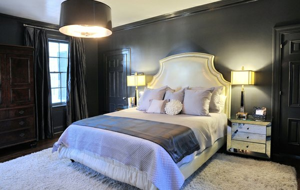 Mirrored surfaces in the master bedroom show off its glamorous shades of lilac, grey, and white.