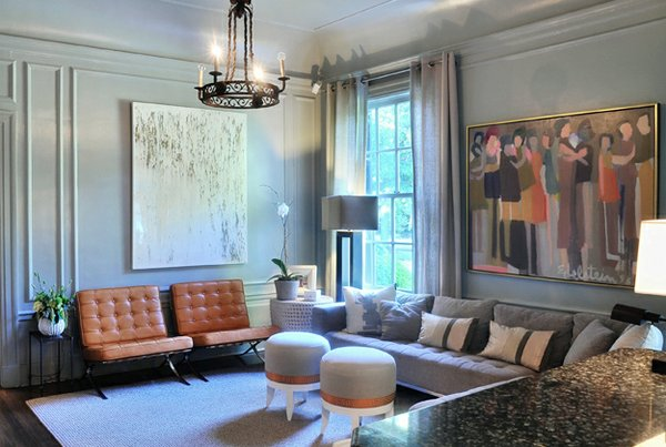 The grey paint palette, Barcelona chair, and Edelstein painting in this sitting room demonstrate a more modern esthetic.