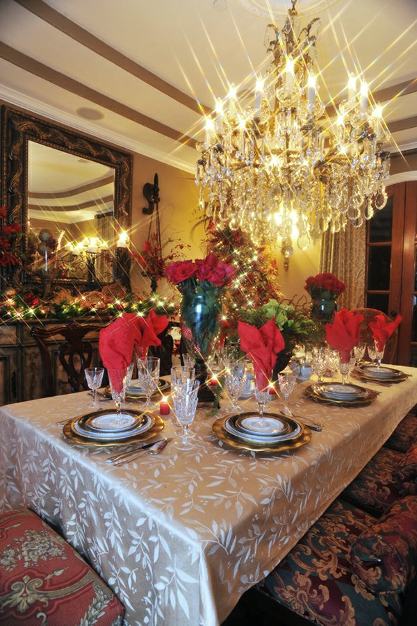 Bryson Cayson set this elegant Yuletide table using the traditional seasonal colors of red, green, and gold.