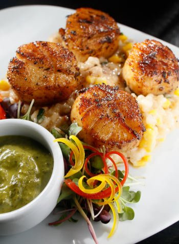 The Waltz features Pan seared scallops with Mache choux risotto and smoked jalapeño-cilantro sambal