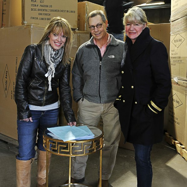 Designer Laurie Jones with Bob Berry and Lucy Woodson in World's Away warehouse.