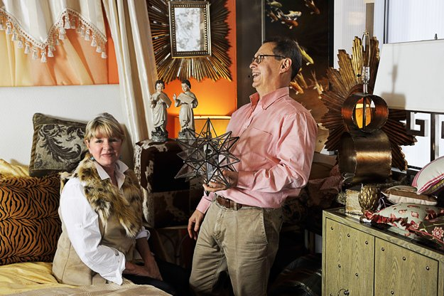 Partners Lucy Woodson and Bob Berry have some fun in the store's small retail section, where flawed items are sold at discount.