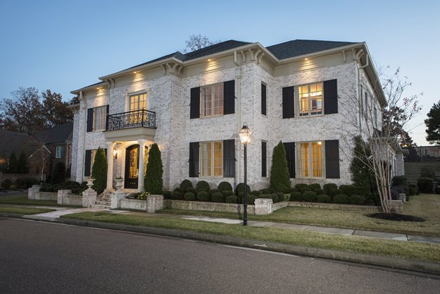 The intricately carved columns are just a hint of the marvelous hand-crafted details to be found inside the Germantown home of Dr. Srikant and Ruta Gir.