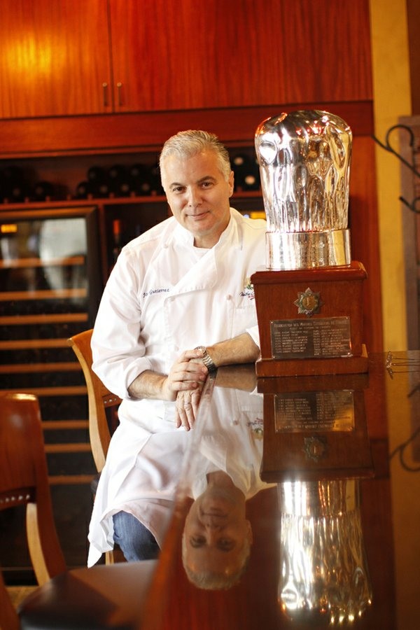 Chef Jose Gutierrez pictured with his espresso maker at River Oaks in 2012.