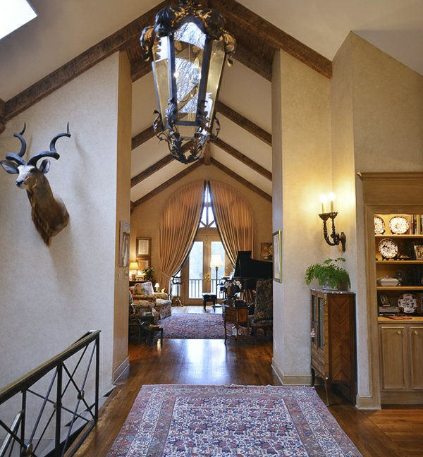 The home's design provides a view form the entrance hall through the house to the gorgeous woodland scene beyond.