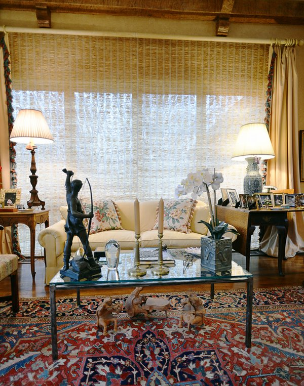 A cozy seating area in the living room features a dramatic sculpture in the foreground of a figure with a longbow – a reference to John Evans' hunting prowess.
