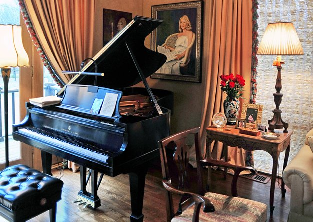 A Steinway grand piano is the dramatic focal point of the Evans' living room.