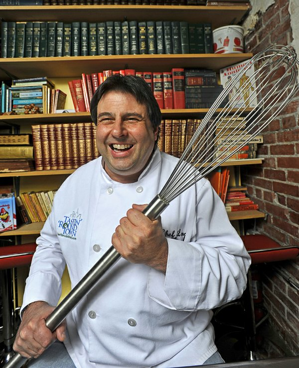 """Chef Lance """"causing a stir"""" with his giant whisk."""