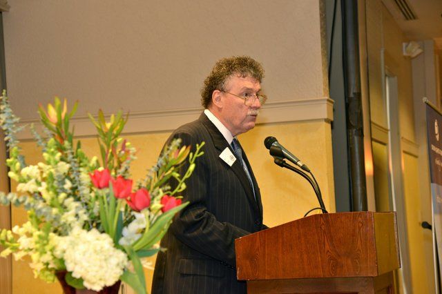 MBQ publisher, Ken Neill, welcoming guests to the 2013 MBQ CEO of the Year Awards breakfast and presentation.