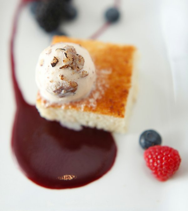 Cornbread pain perdue with vanilla bean ice cream and berry coulis.