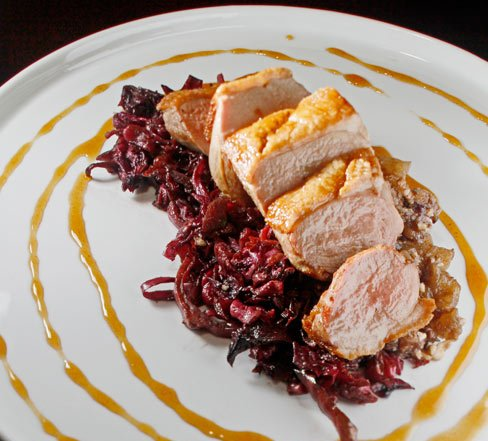Duck breast pan seared and topped with braised red cabbage, apple bacon chutney, and apple cider gastrique.
