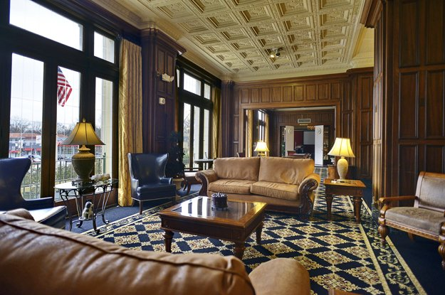 The handsome lobby with original walnut paneling and hand-carved ceilings offers a grand welcome as it has for 90 years.