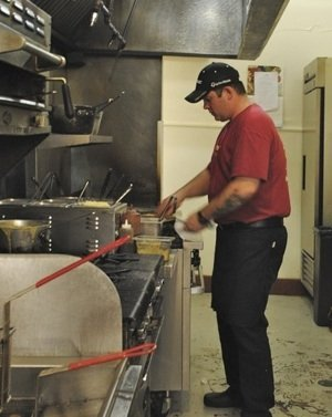 Cortona Chef Nate Olivia, a former chef de cuisine at Erling Jensen, cooks in his new kitchen in Cooper-Young.