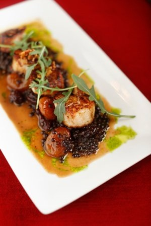 Day boat scallops at Paulette's are plated with an apple cider gastrique.