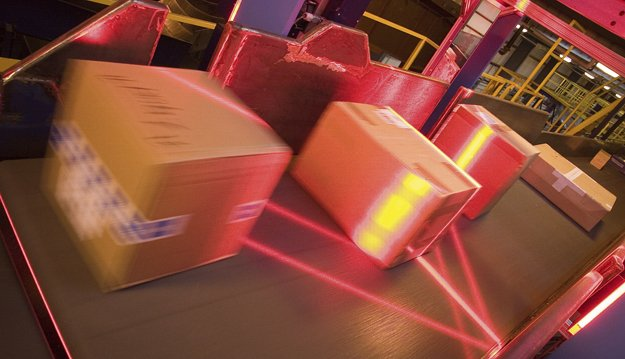 FedEx packages pass through scanning tunnels at the hub. An average package will be scanned more than 12 times from pickup to delivery.