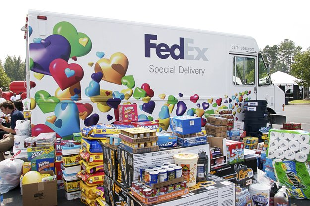 Employees at World Headquarters in Memphis load a truck with relief supplies bound for FedEx employees affected by Hurricane Katrina.