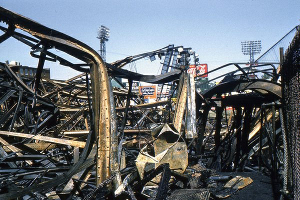 Daylight revealed the full extent of the fire that consumed Russwood Park: steel beams twisted by the intense heat, scorched cars, and burned-out buildings along Madison.