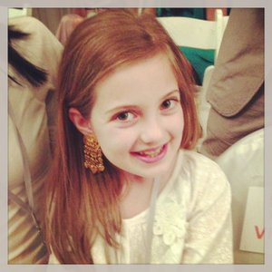Emerson (wearing vintage Chanel earrings) shows that fashion is loved by all girls of all ages.