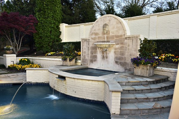 Eliminating drapes and replacing small-paned windows opened up the backyard  view of this fabulous fountain and pool.